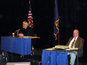 Judge MacKenzie holding court in a local school.